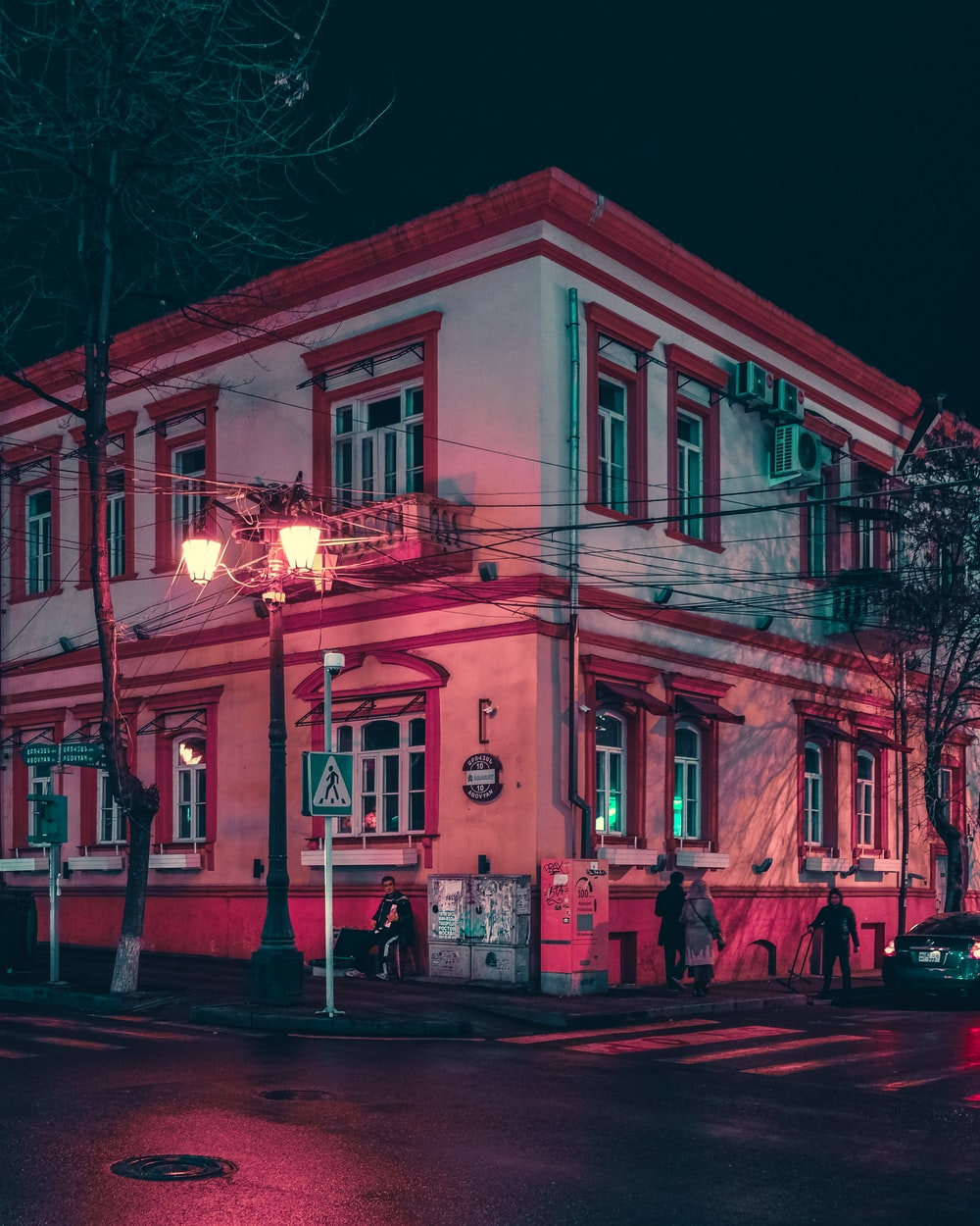 red and white concrete building during night time