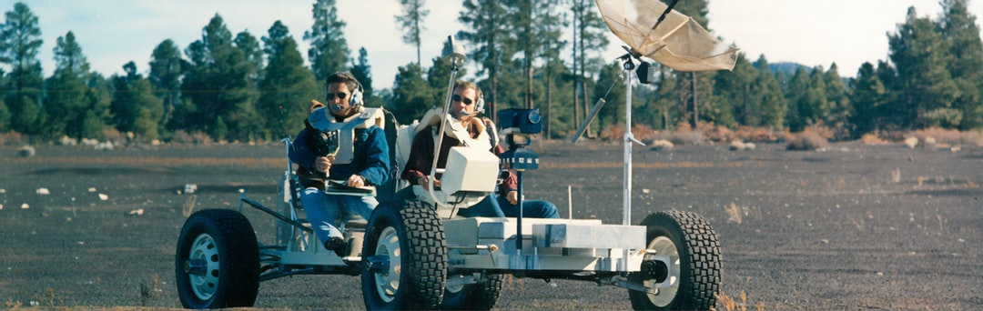 """James Irwin(left) and David Scott(right) training in the Lunar Roving Vehicle training version known also known as the """"Grover"""""""