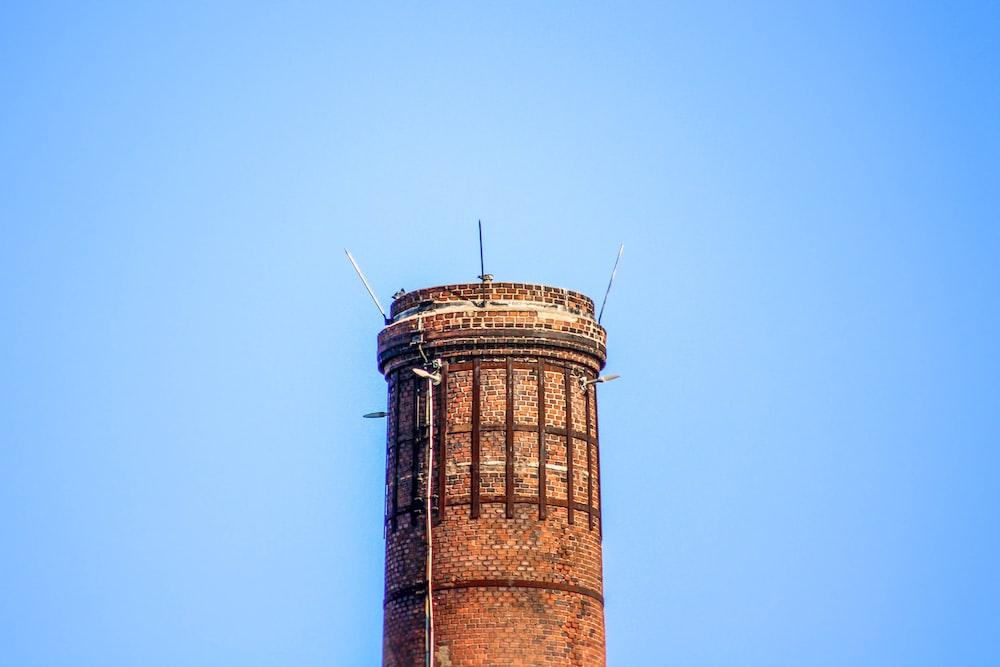 brown brick tower under blue sky
