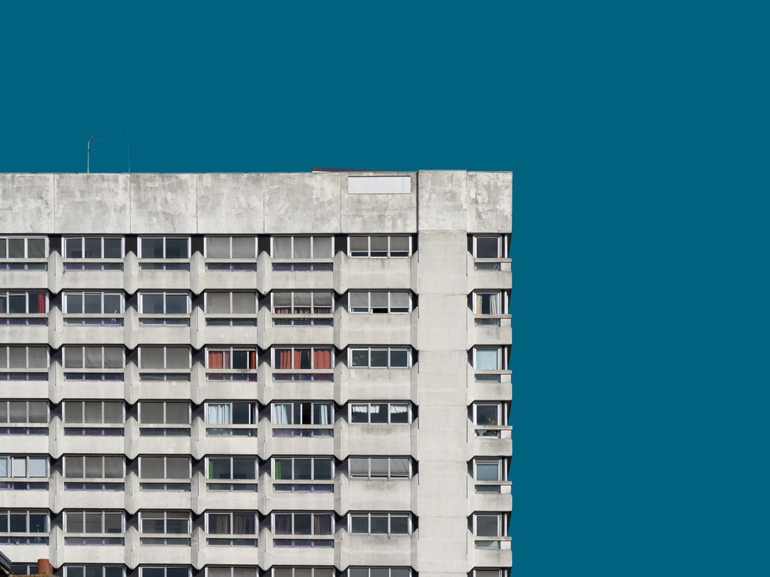 White Concrete Building Under Blue Sky During Daytime - unsplash