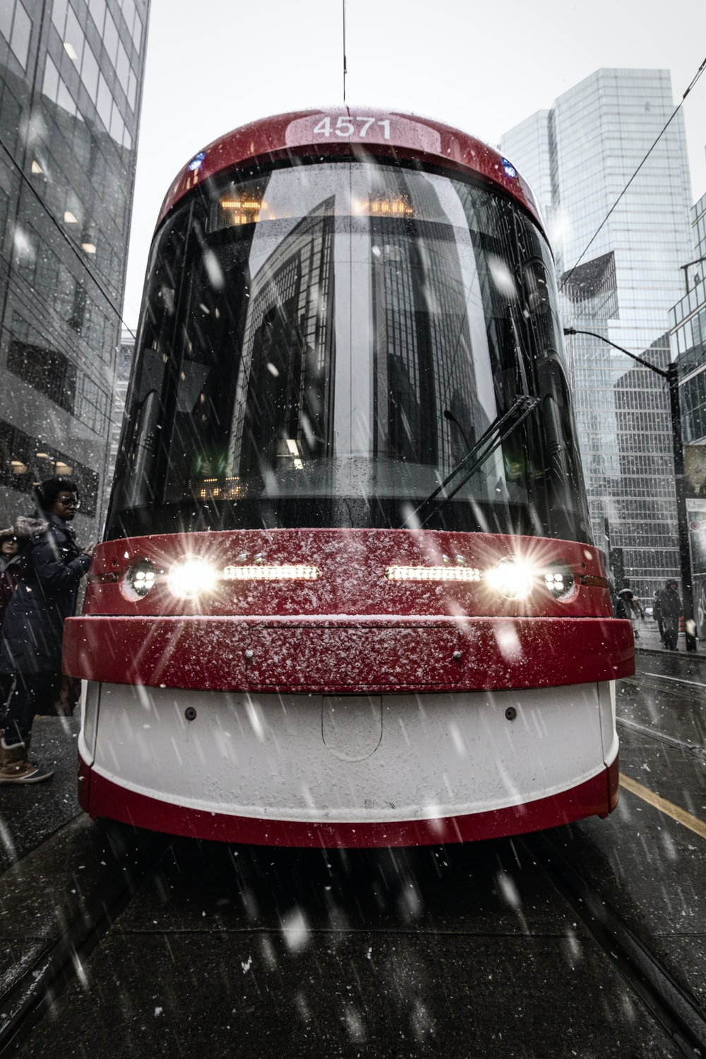 red and white train on the street