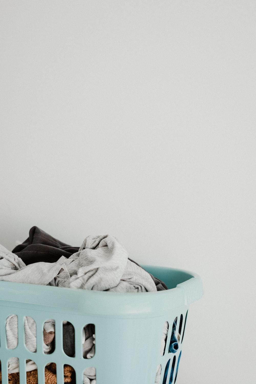 white textile in blue plastic container