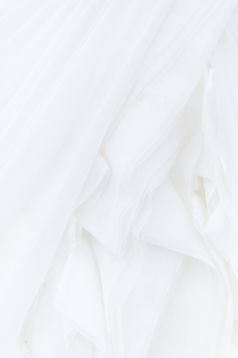 white textile in close up photography