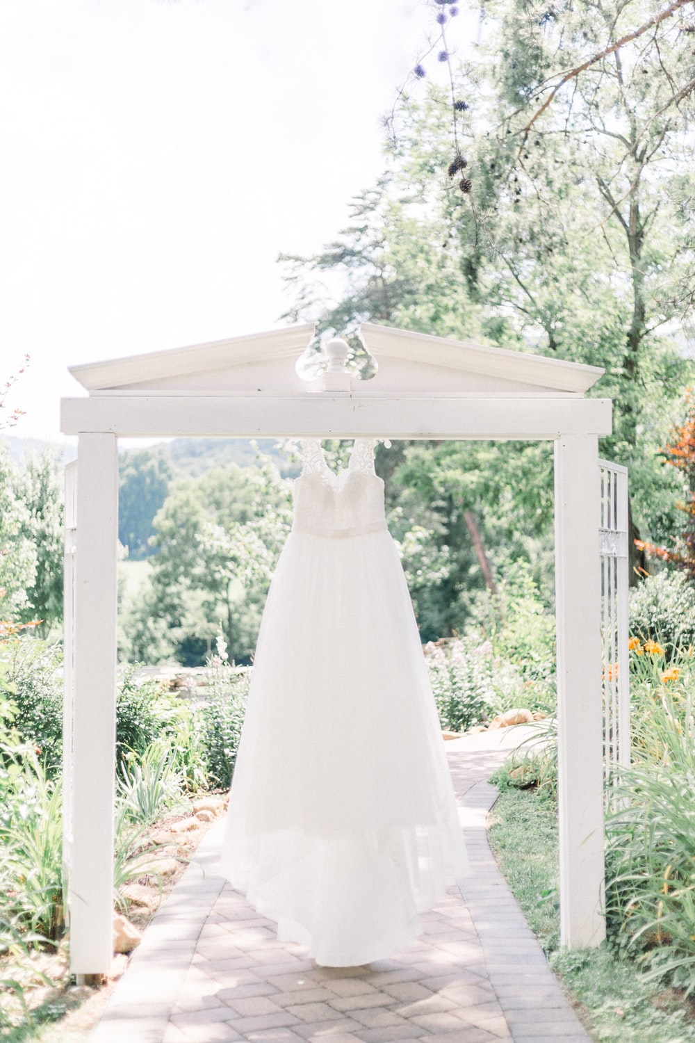 white wedding gown on white wooden frame