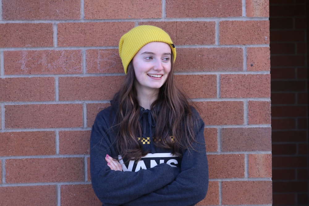 woman in yellow knit cap and blue jacket