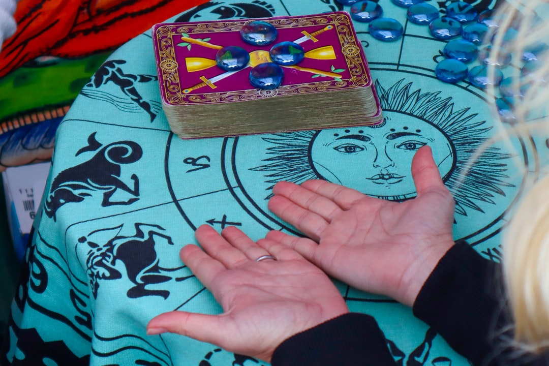 Palm reading with Tarot cards