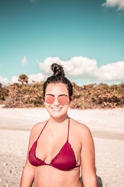 woman in pink bikini top on beach during daytime
