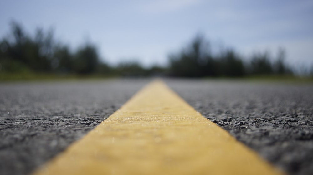 brown wooden plank on gray concrete road during daytime
