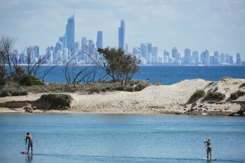 city skyline across blue sea during daytime
