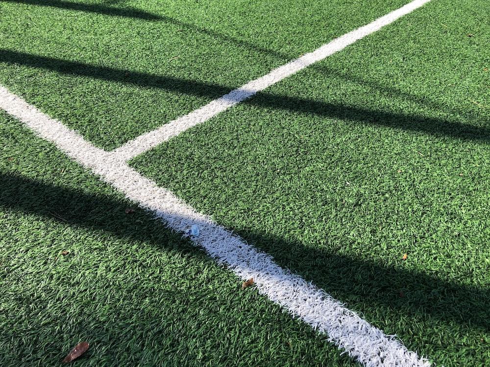 white line on green grass field