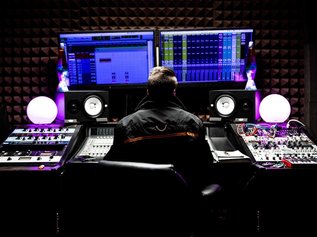 Man In Black Jacket Sitting In Front of Computer - unsplash
