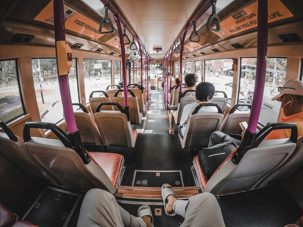 people sitting on bus seat