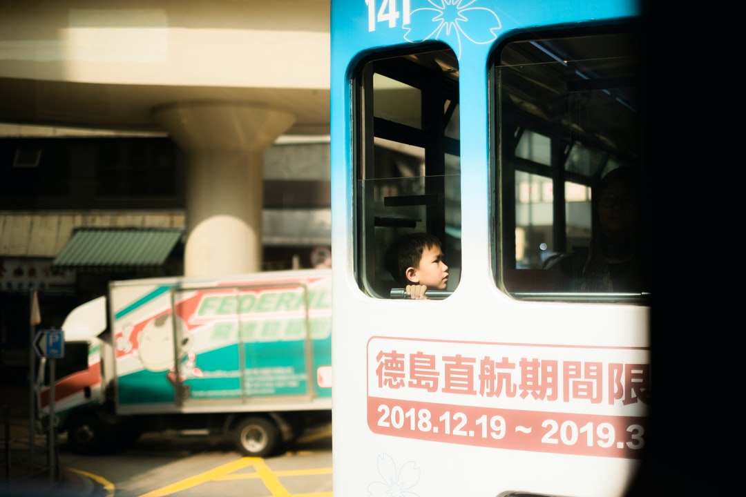 Child / Sunny / Sunshine / Bus / Street - unsplash