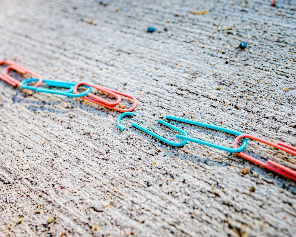 blue green and red plastic clothes pin