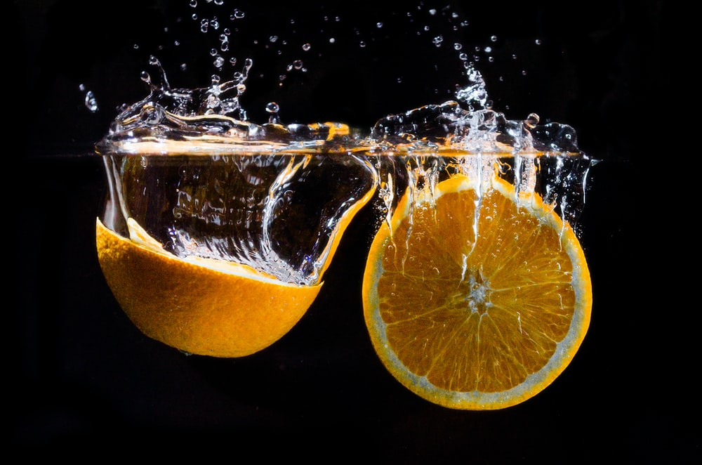 orange fruit in water with water