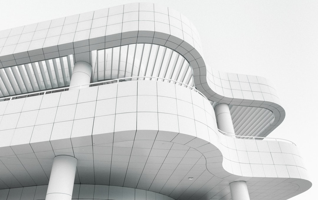 Modern Building With A Wave Shaped Exterior   - unsplash