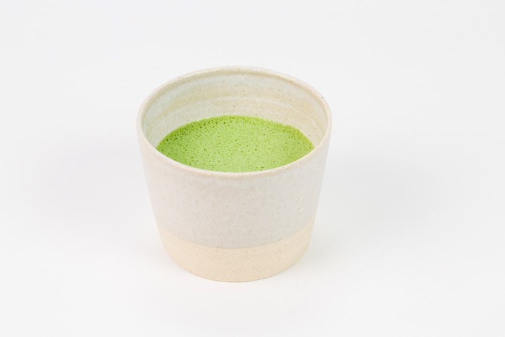 green and white ceramic cup