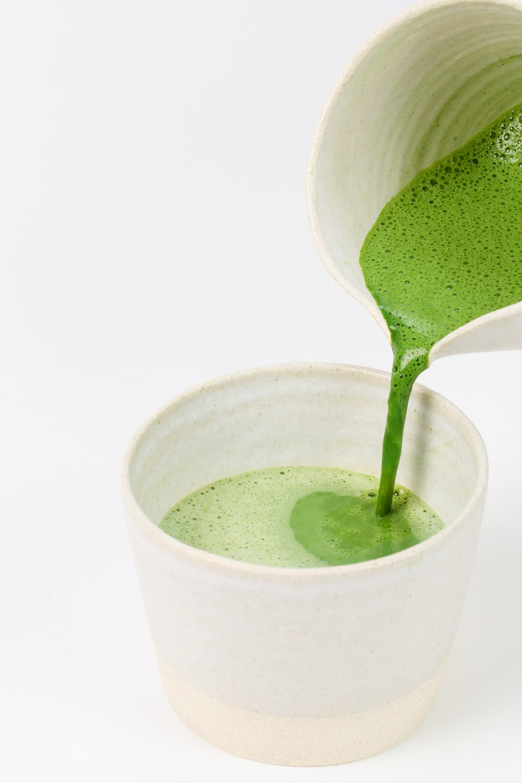 green liquid in white ceramic cup