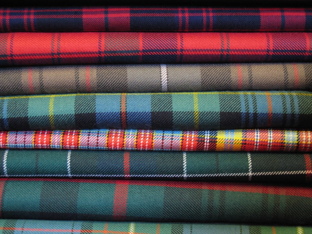 red blue and black striped textile