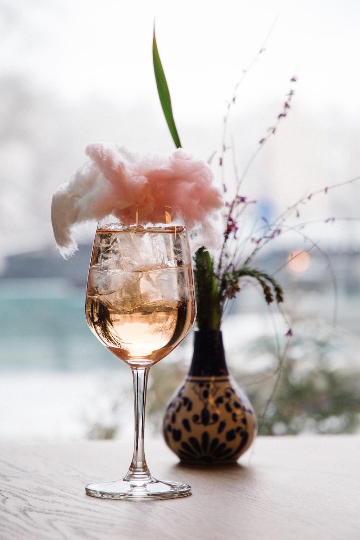 pink flower in clear glass bottle
