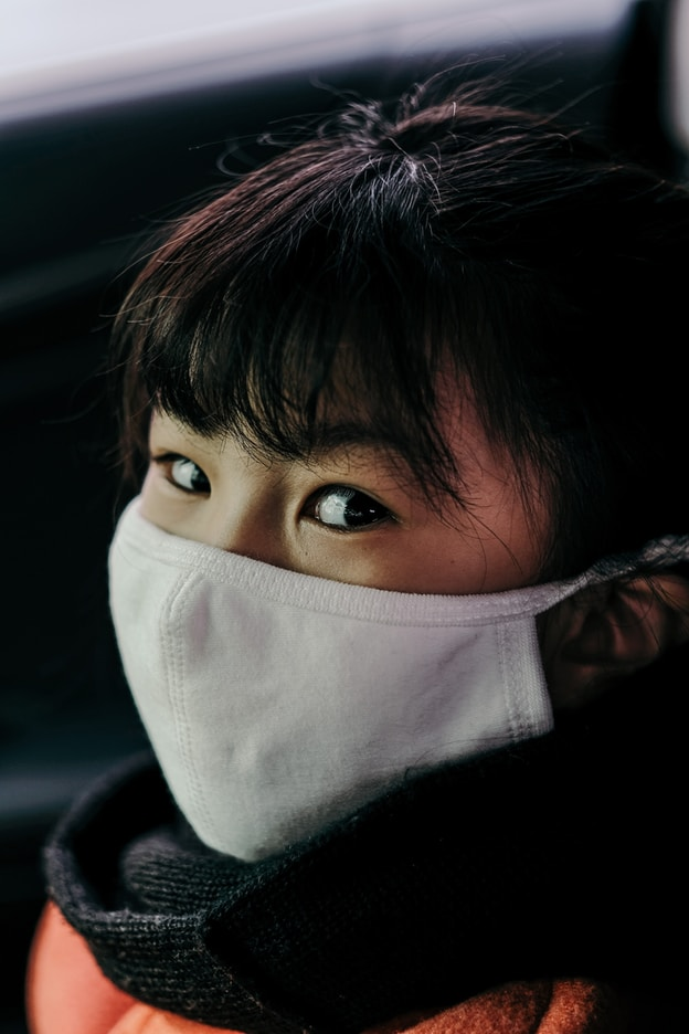 girl with white face mask