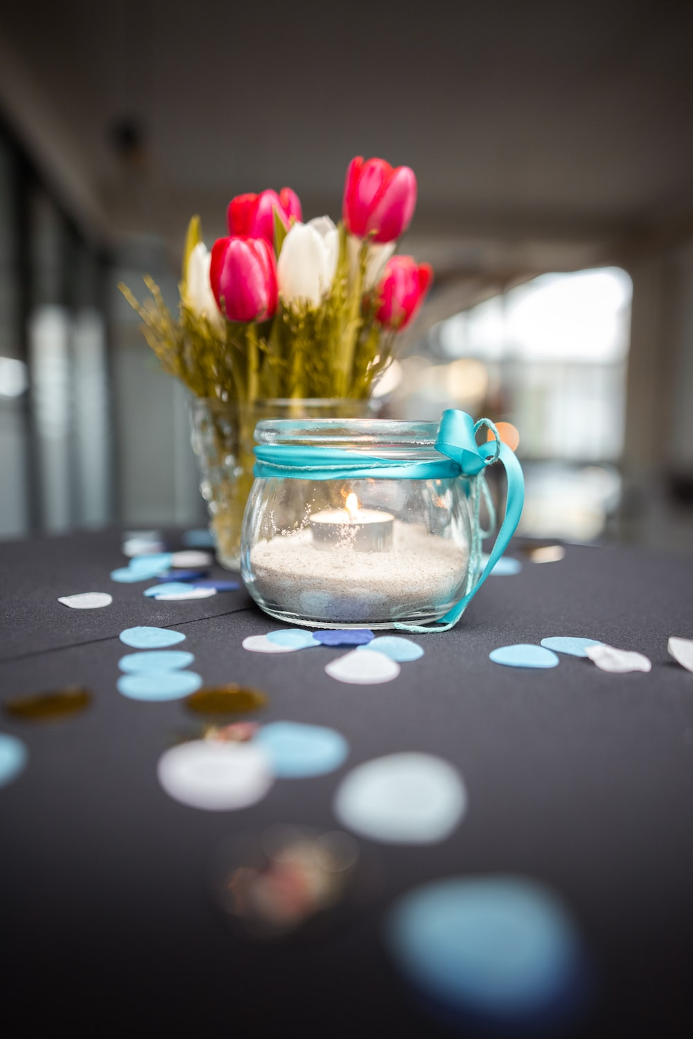 pink tulips in clear glass jar