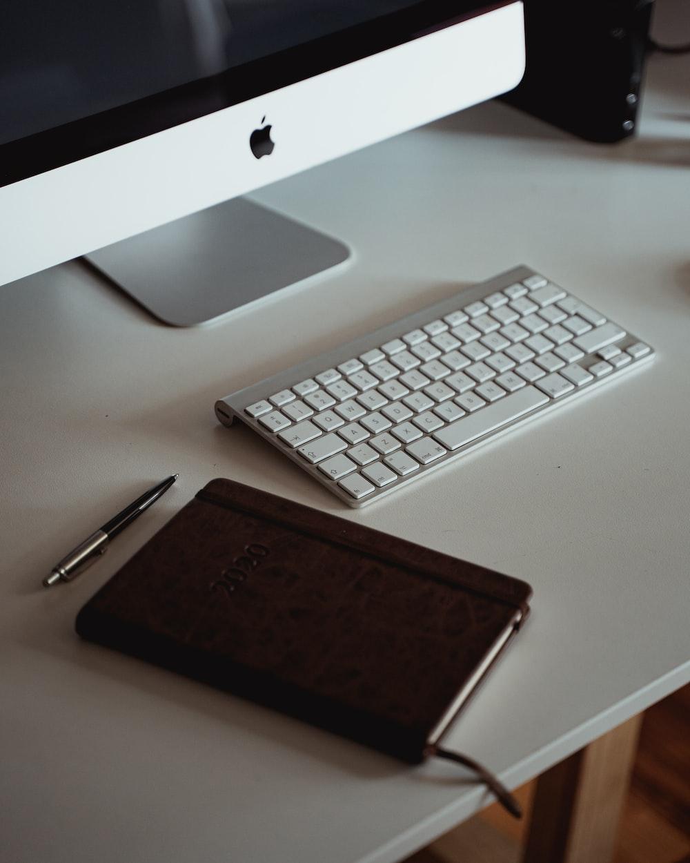 silver imac and apple keyboard