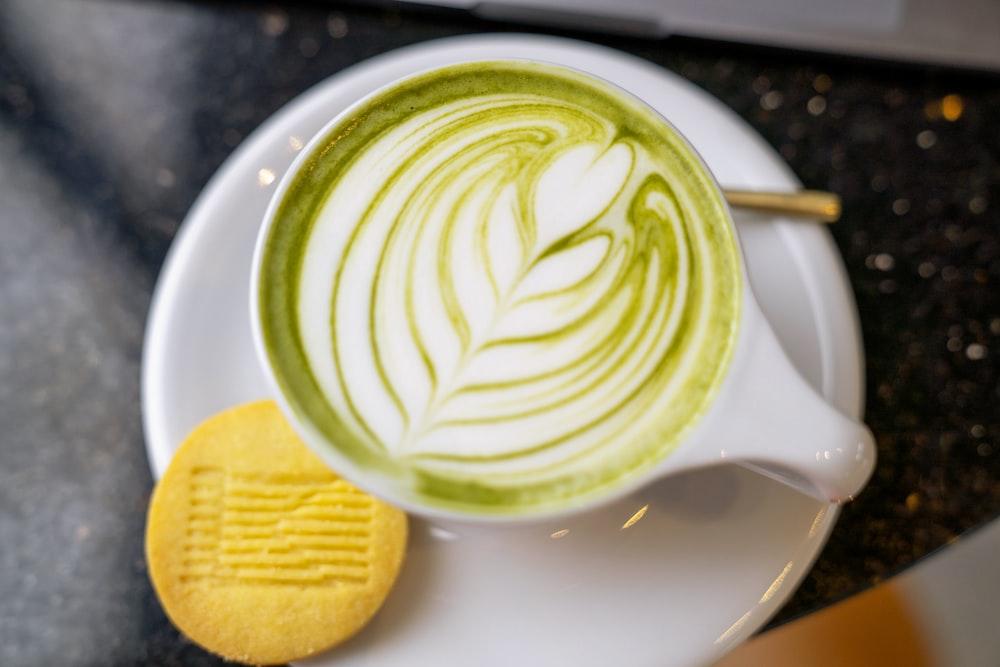 white ceramic mug with green and white liquid