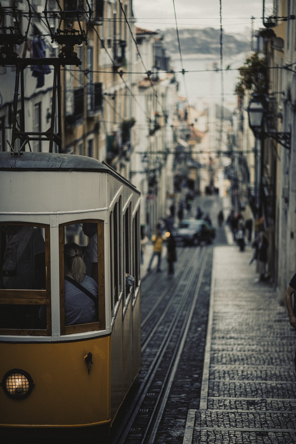 yellow and white tram on street during daytime