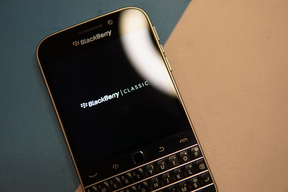black and silver blackberry qwerty phone