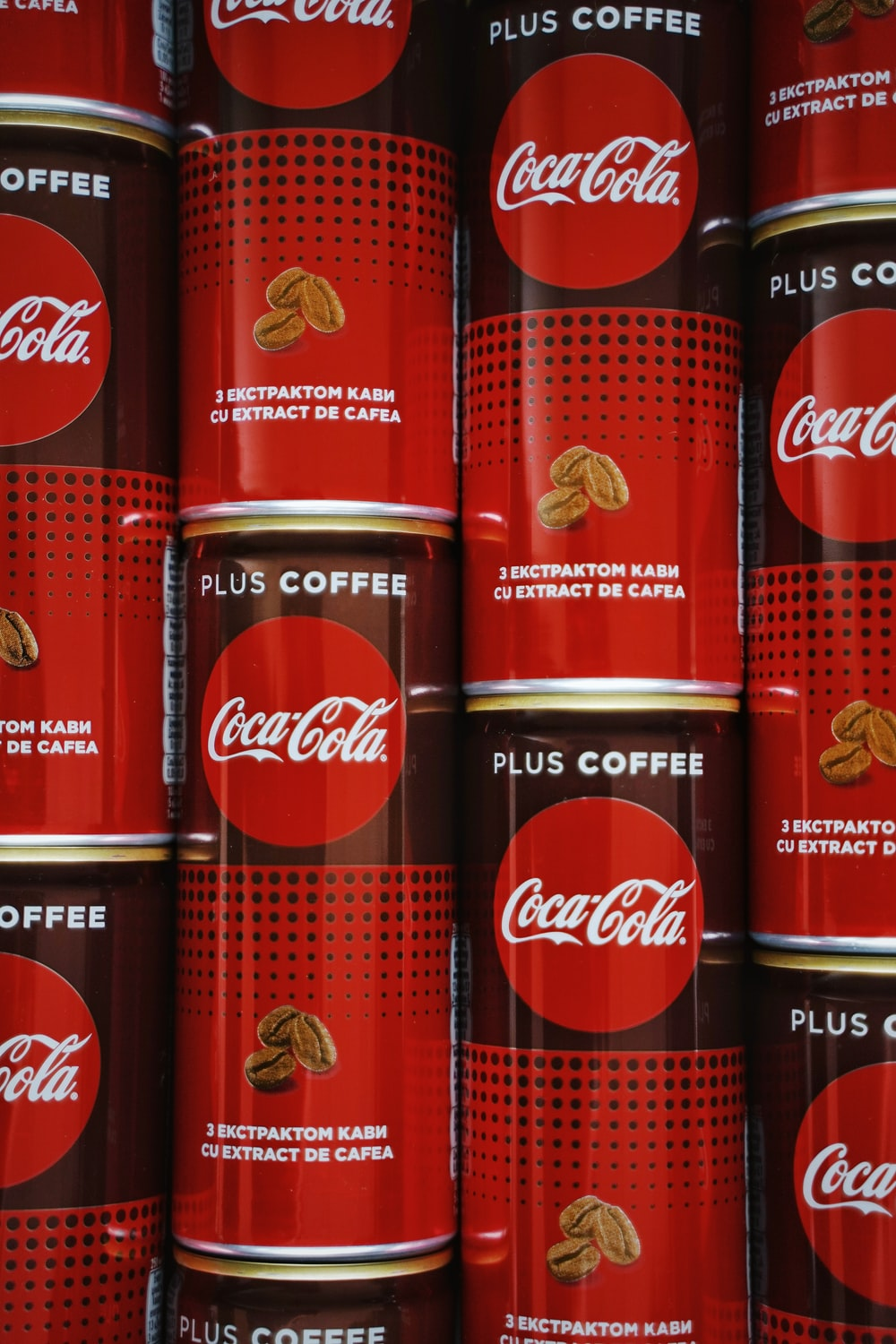 coca cola can on brown wooden table