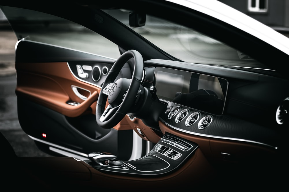 black and orange car steering wheel
