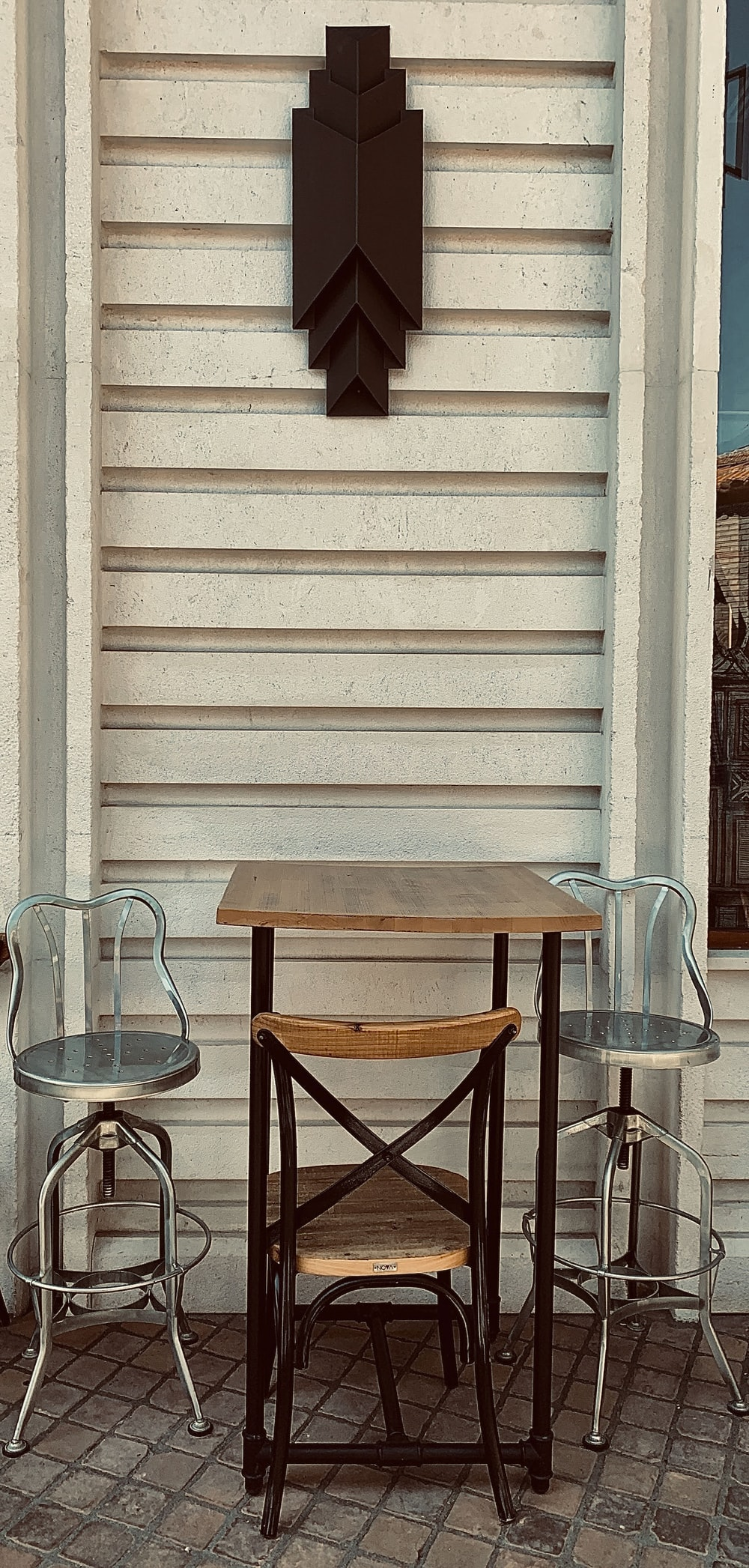 stainless steel framed brown wooden chair