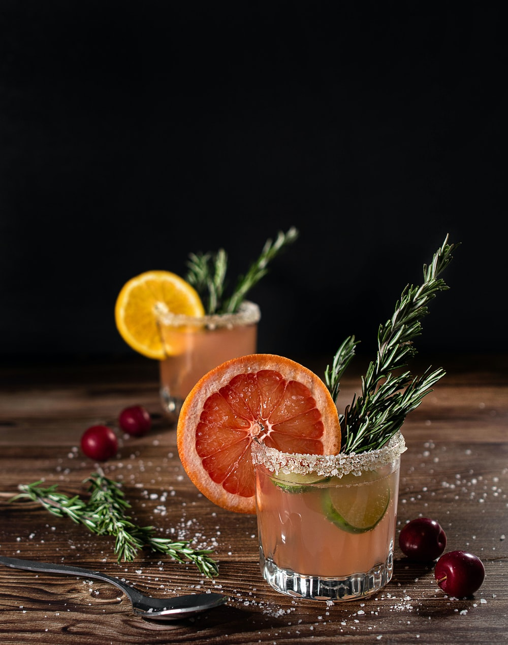 orange fruit on clear drinking glass