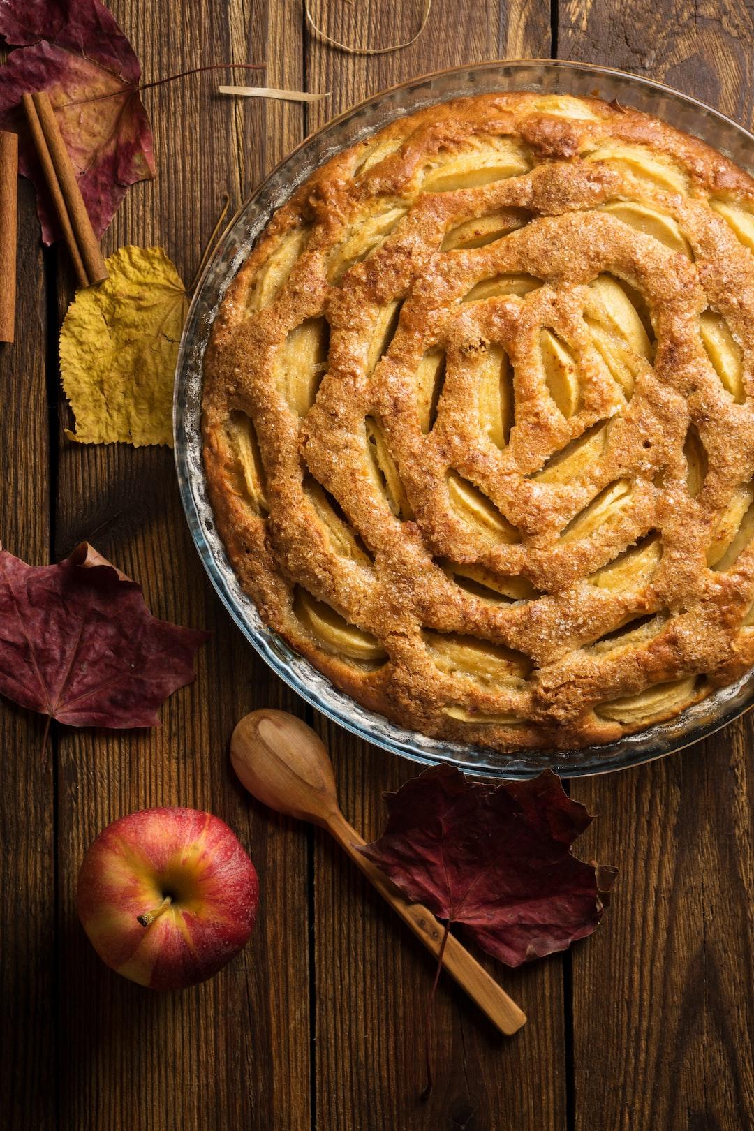 Apple pie on wooden background