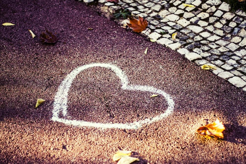 white heart on gray concrete floor