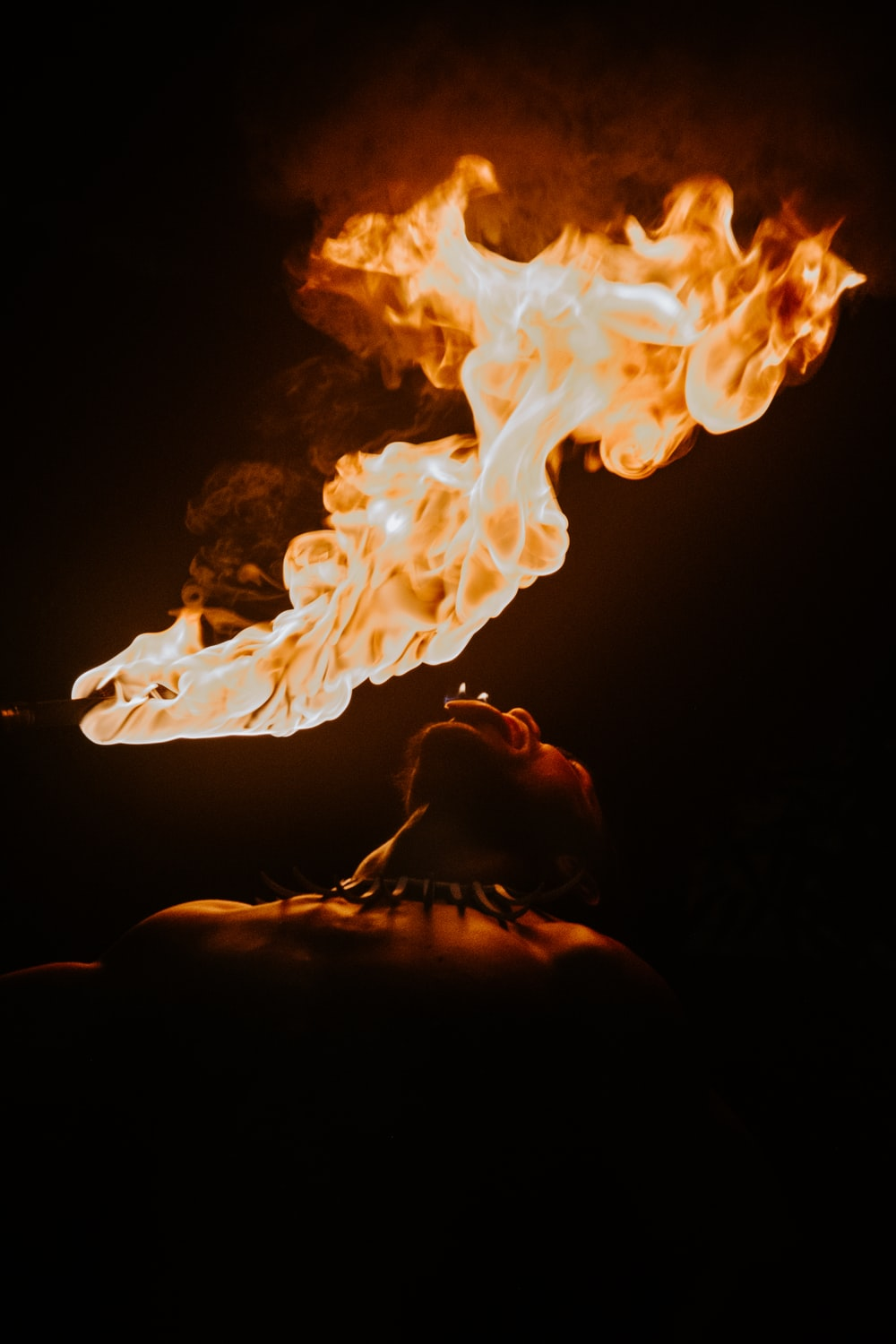 fire in dark room with black background