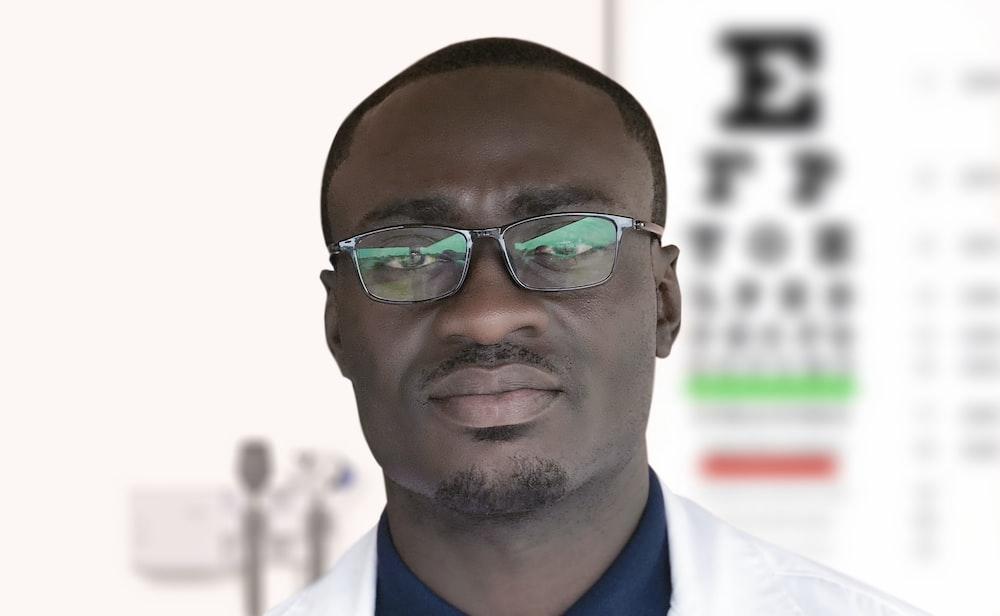 man in blue and white suit wearing black framed eyeglasses