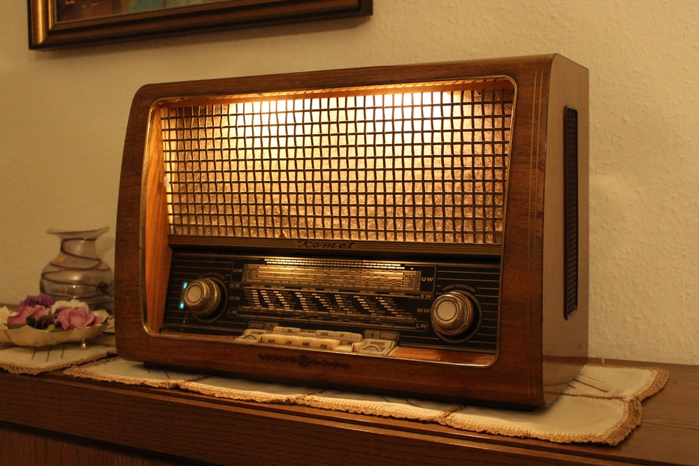 brown and black radio on brown wooden table