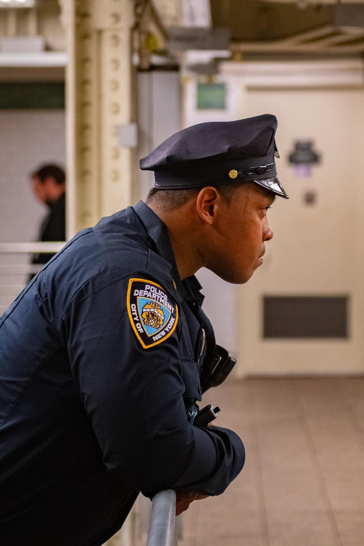 man in blue police uniform