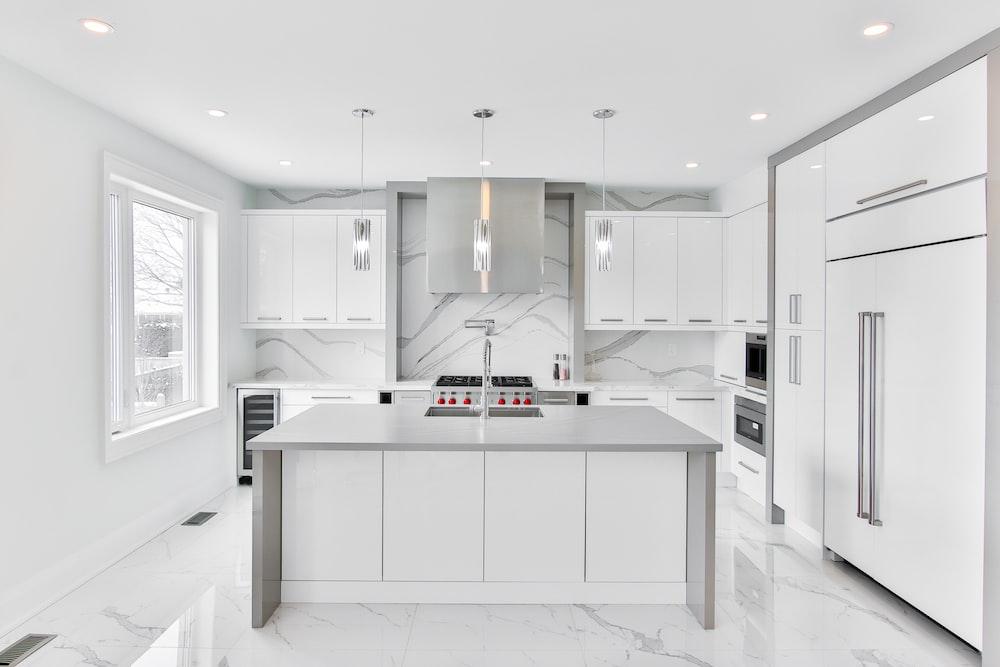white wooden kitchen cabinet with mirror