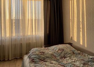 white and brown window curtain