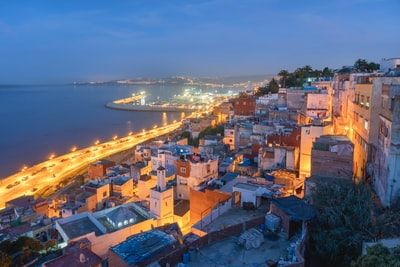 Tangier aerial view of city near body of water during night time