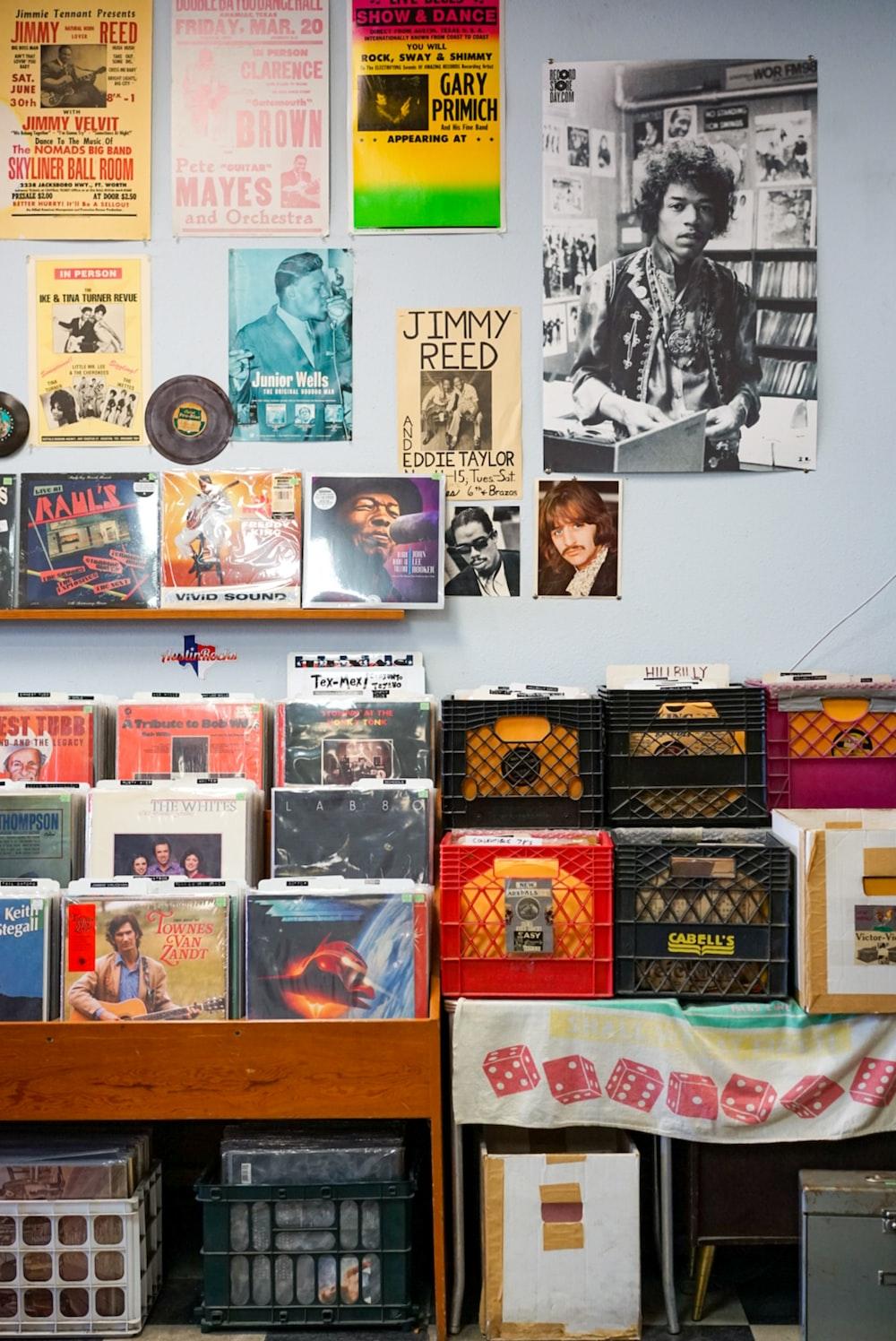 assorted vinyl record on brown wooden shelf