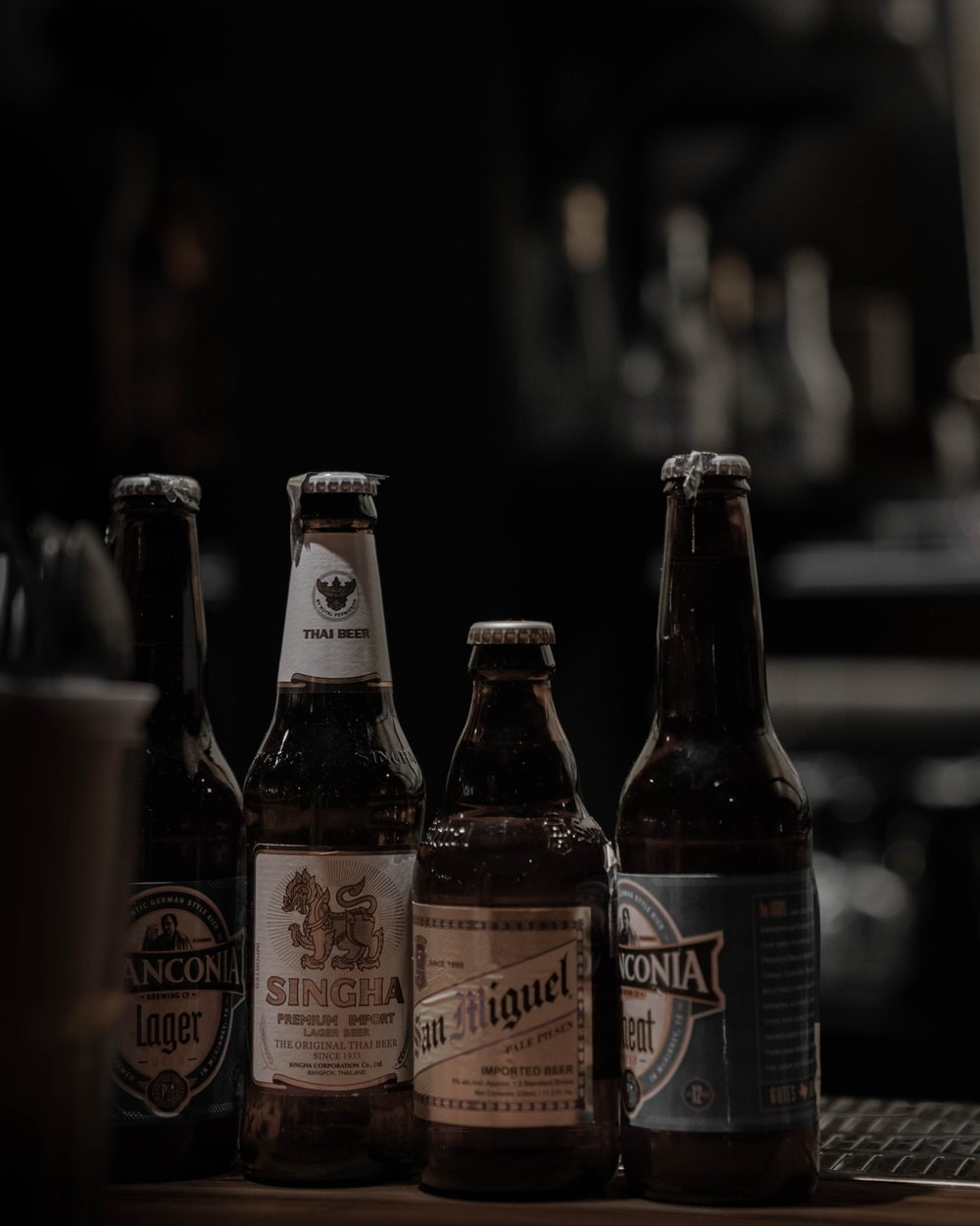 selective focus photography of brown glass bottle