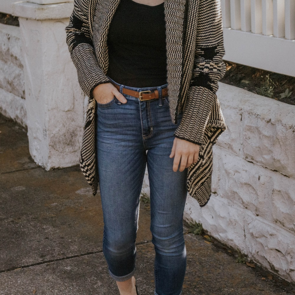 woman in black and white striped long sleeve shirt and blue denim jeans