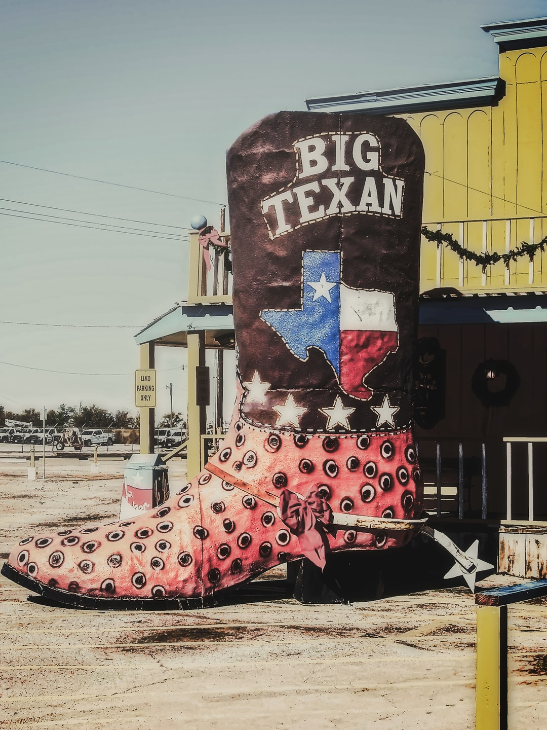 A giant ostrich book with spurs outside The Big Texan Steak House in Amarillo, Texas, USA on a very hot and sunny November afternoon (2008).