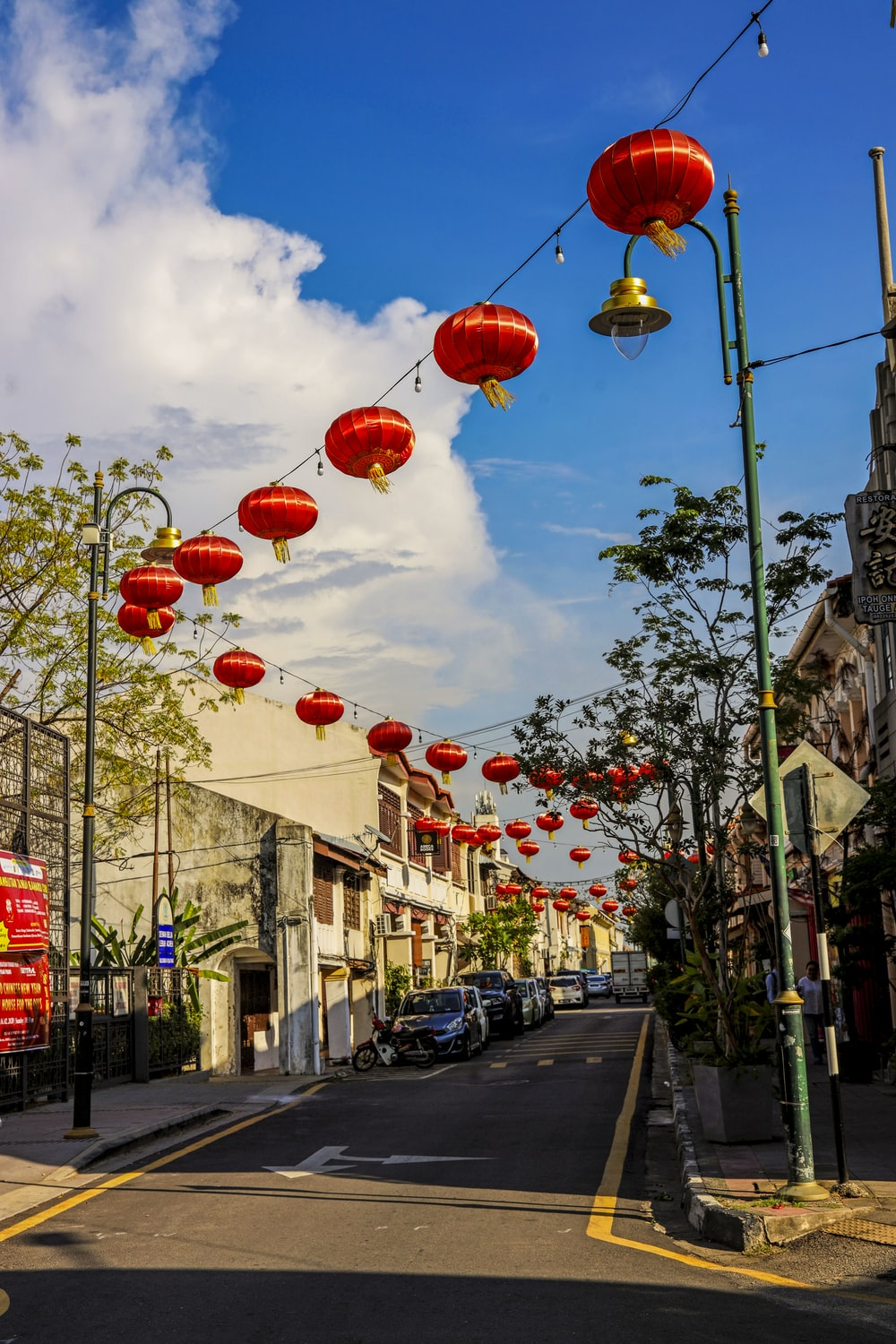red and yellow lanterns on street during daytime