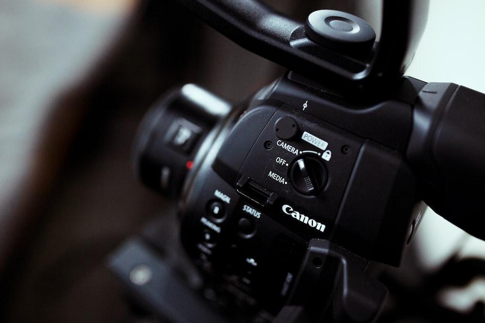 black dslr camera on black surface