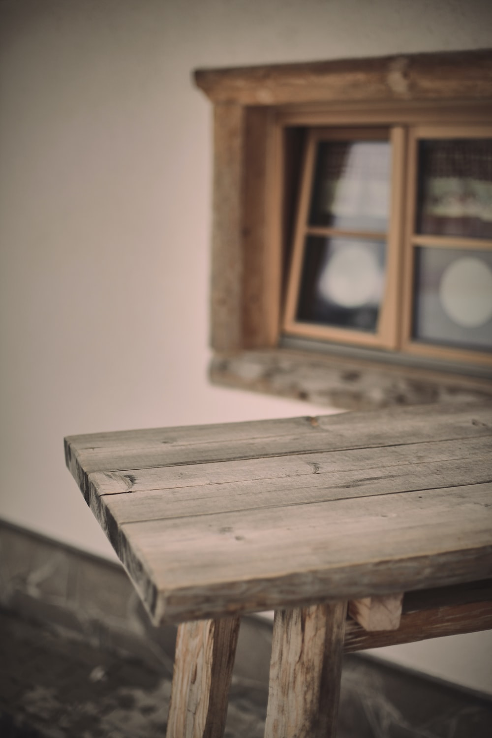 brown wooden window frame with white wall